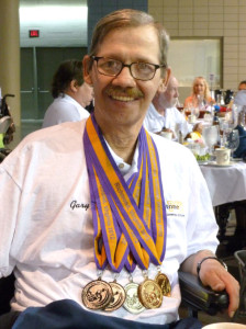 Gary Orlando with medals at the 2013 National Veterans Wheelchair Games in Tampa, Florida.